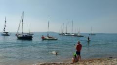 Club boats at anchor off Ringstead beach