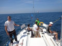 The crew of Gwaihir Venturi relax after winning their class in the Tour des Ports