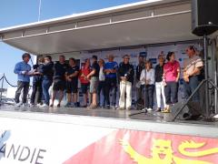 Thierry, Georges (centre) and others on the podium at Le Havre